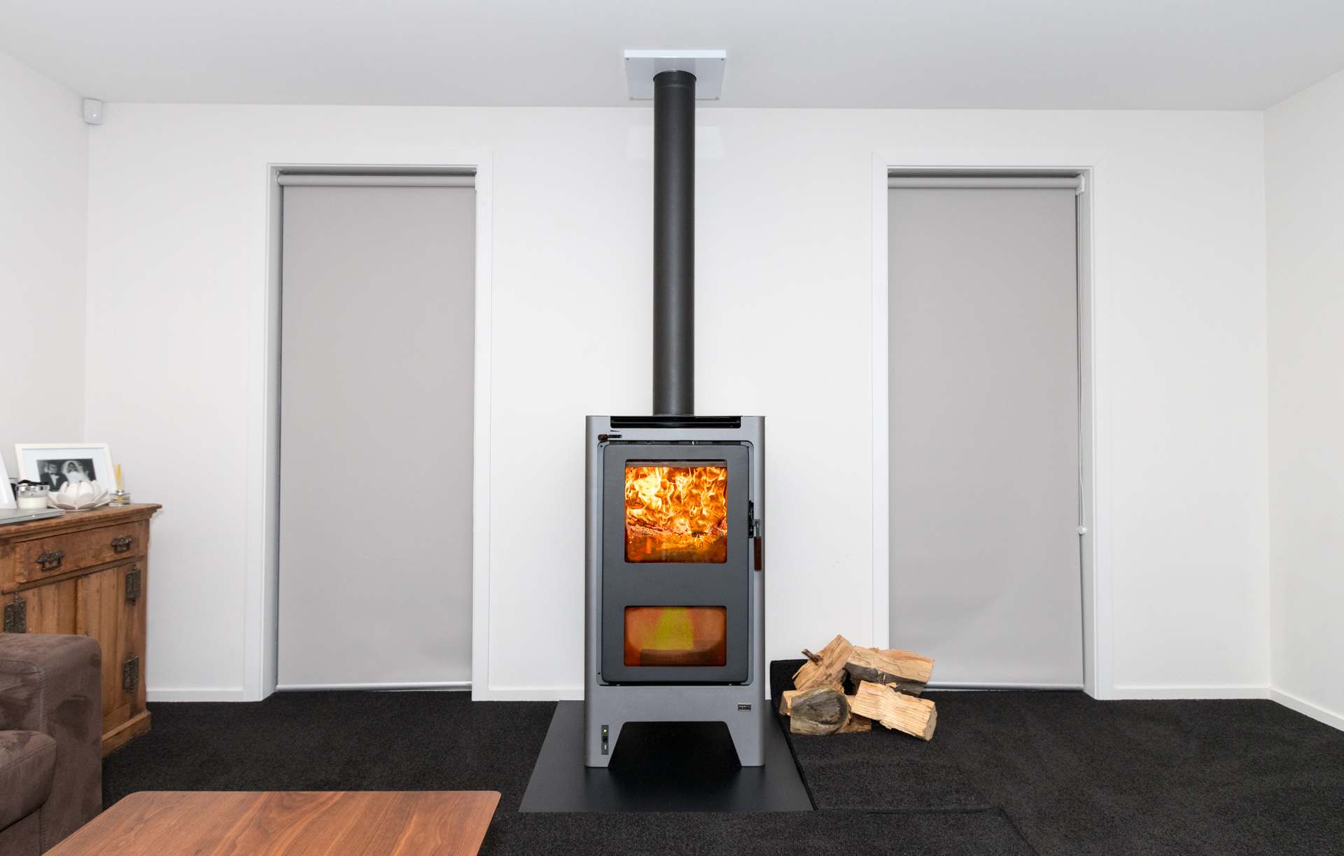 a very tidy free standing fire in a home