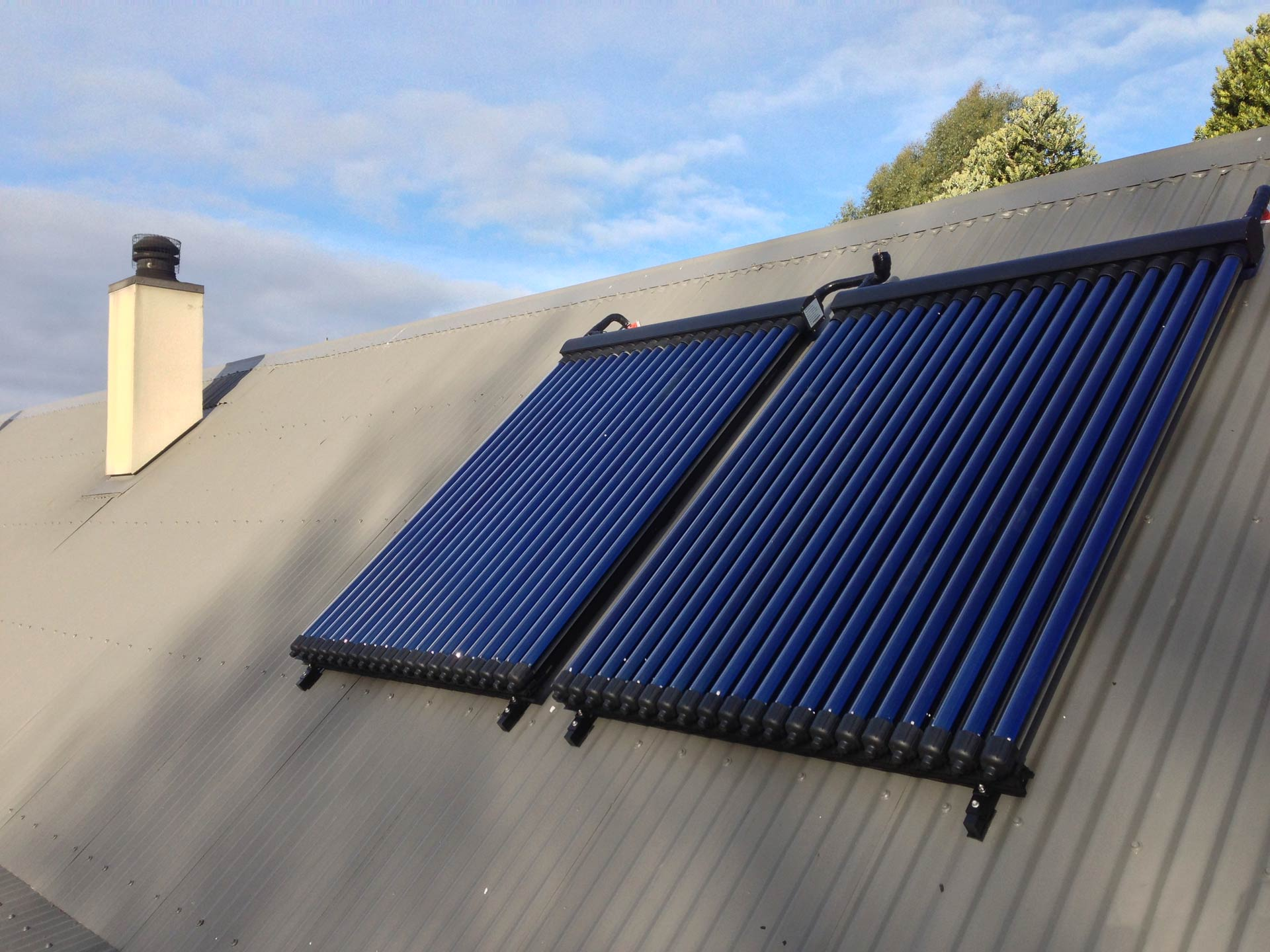 two solar panels on a steep roof