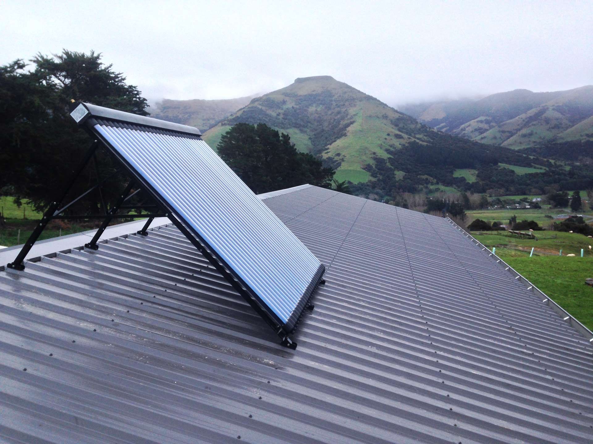 solar panel on an upstanding overlooking fields and hills